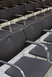 Black chairs in a row Royalty Free Stock Photo