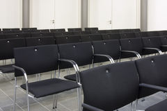 Black chairs in a row Stock Image