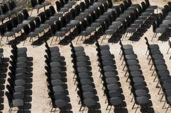 The black chairs in a row. Black chairs in a row Stock Photography