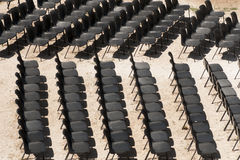 Black chairs in a row. Italy Stock Photography
