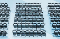 Black chairs set in the audience, top view. Stock Image