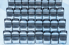 Black chairs set in the audience, top view. Royalty Free Stock Images