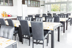 Black chairs and table in eaten zone Royalty Free Stock Photography