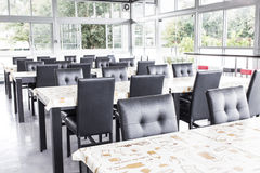 Black chairs and table in eaten zone Royalty Free Stock Image