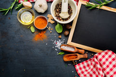 Black chalk board and spices Royalty Free Stock Photo