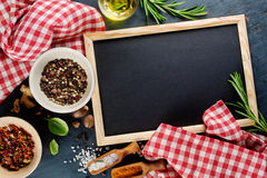 Black chalk board and spices. Royalty Free Stock Photo