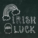 Black Chalkboard Background Irish Luck Lettering with Rainbow and Pot of Gold. 17 March Celebration St Patricks Irish Day Illustra. Black Chalkboard Background Stock Photography