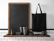 Black chalkboard on bookshelf with set of branding objects. 3d rendering Royalty Free Stock Photo