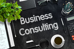 Black Chalkboard with Business Consulting. 3D Rendering. Stock Images