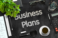 Black Chalkboard with Business Plans Concept. 3D Rendering. Stock Photos