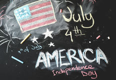 Black chalkboard in classroom with American flag Royalty Free Stock Photography