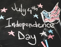 Black chalkboard in classroom with American flag Stock Images