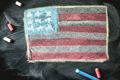 Black chalkboard in classroom with flag of us Royalty Free Stock Photos