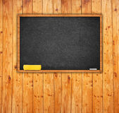 Black chalkboard in classroom Stock Photography
