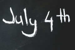 Black chalkboard in classroom ...4 th of July Stock Photography