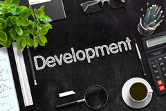 Black Chalkboard with Development. 3D Rendering. Development. Business Concept Handwritten on Black Chalkboard. Top View Composition with Chalkboard and Office Royalty Free Stock Image