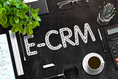 Black Chalkboard with E-CRM Concept. 3D Rendering. Royalty Free Stock Photography
