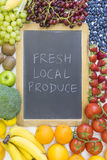 Black chalkboard for fresh local produce Royalty Free Stock Image