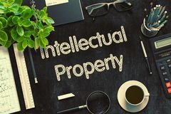 Black Chalkboard with Intellectual Property. 3D Rendering. Royalty Free Stock Photo