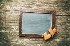 Black chalkboard and hearts. Royalty Free Stock Photos