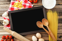 Black chalkboard for menu on brown wooden background Stock Images