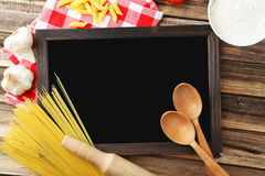 Black chalkboard for menu on brown wooden background Royalty Free Stock Images