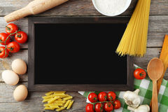 Black chalkboard for menu. On grey wooden background stock photos