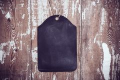 Black chalkboard on old wooden board background Royalty Free Stock Photos