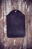 Black chalkboard on old wooden board background Stock Photo