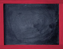 Black chalkboard with red wooden frame Royalty Free Stock Image