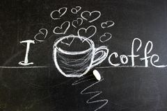 A black chalkboard that says I love coffee . Melon painted coffee Cup, heart. The inscription for a coffee shop or cafe. Copy space stock image