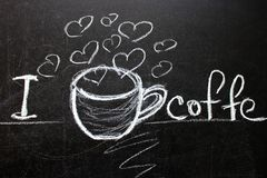 A black chalkboard that says I love coffee . Melon painted coffee Cup, heart. The inscription for a coffee shop or cafe. Copy space royalty free stock images