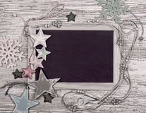 Black chalkboard with various winter decorations Royalty Free Stock Photos