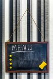 Black chalkboard on the wall. Cafe menu stock photography