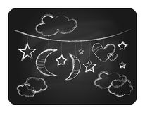 Black chalkboard with white clouds moon and stars Stock Images