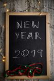 Black chalkboard with the written words NEW YEAR 2019 royalty free stock photos