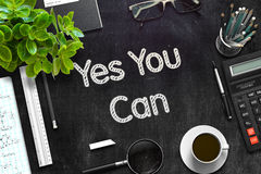 Black Chalkboard with Yes You Can Concept. 3D Rendering. Yes You Can. Business Concept Handwritten on Black Chalkboard. Top View Composition with Chalkboard and Royalty Free Stock Images