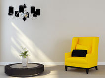 Black chandelier and yellow chair Stock Image