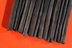 Black charcoal sticks, art supplies. Stock Photo