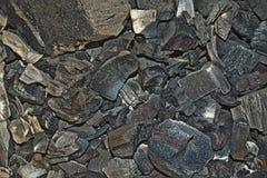 Black charcoal texture background.selective focus stock photos