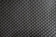 Black checkered polyester fabric from above Stock Photos