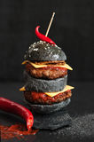 Black cheeseburger with meat Royalty Free Stock Image
