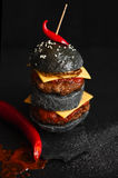 Black cheeseburger with meat Royalty Free Stock Photos