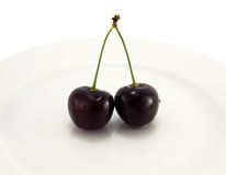 Black cherry on a plate Royalty Free Stock Images