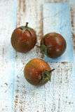 Black cherry tomatoes Royalty Free Stock Images
