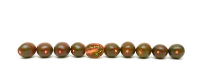 Black cherry tomatoes on a white background Royalty Free Stock Images