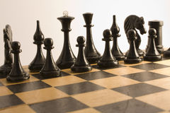 Black chess. Are placed on a wooden chess board for the beginning games Royalty Free Stock Photos