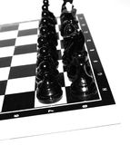Black chess. Black  chess on a chess board Royalty Free Stock Images