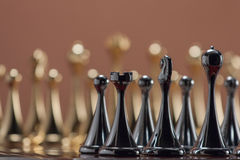 Black chess castle. The photo shows the chessboard with metal figures Royalty Free Stock Image