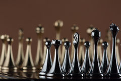 Black chess figures. The photo shows the chessboard with metal figures Royalty Free Stock Photos